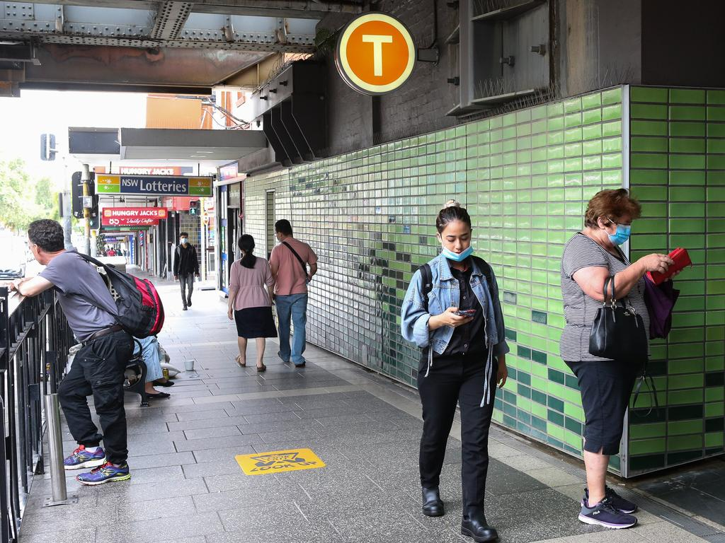 Sydneysiders at Burwood Train Station wore masks after new NSW government regulations were introduced on the weekend and $200 fines issued from Monday. Picture: NCA NewsWire / Gaye Gerard