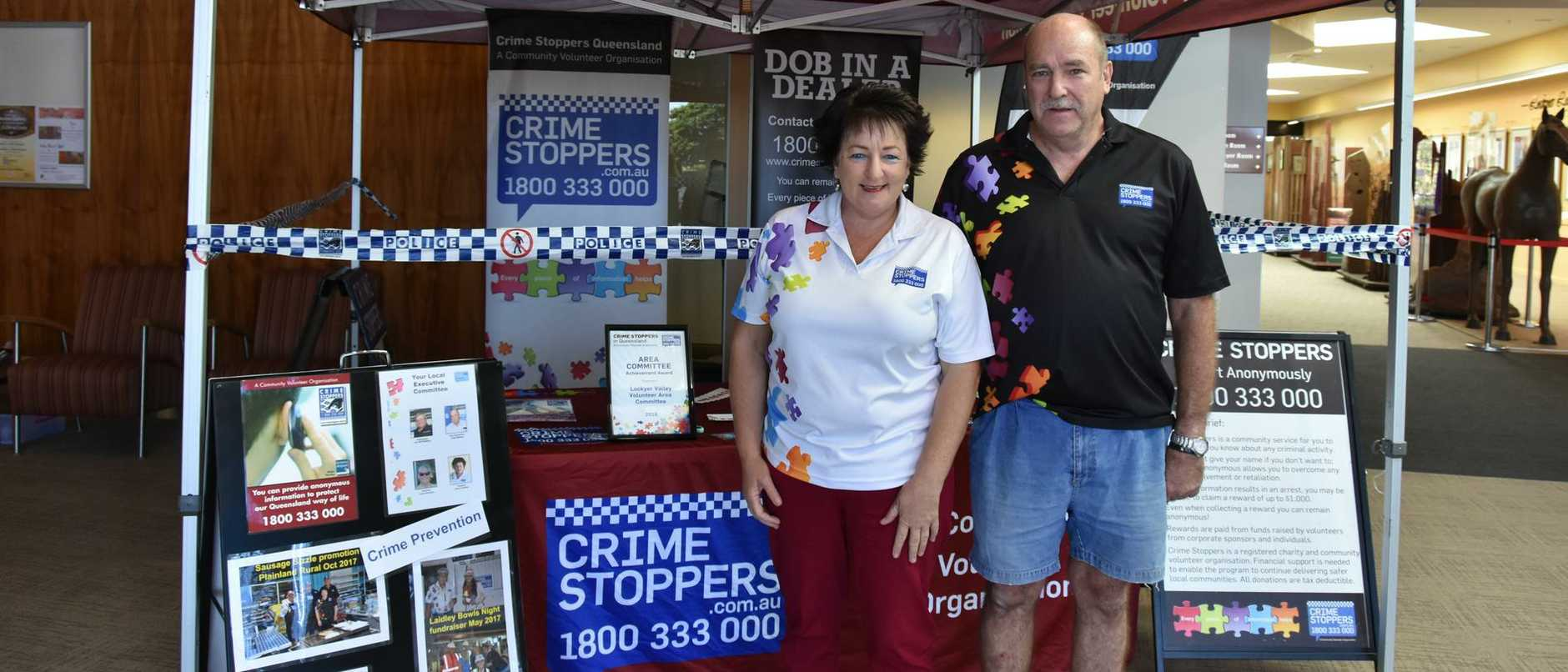 Greg Steffens and Janice Holstein at the stand the committee set up in preparation for National Crimestoppers Day at the Lockyer Valley Cultural Centre.