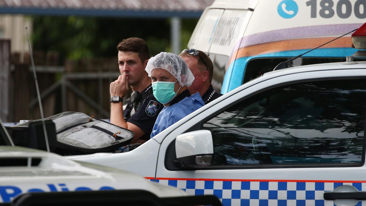 Police officers attend Hambledon State School at Edmonton in February, where a 3 year old was found dead in a Goodstart Early Learning Centre minibus. PICTURE: BRENDAN RADKE