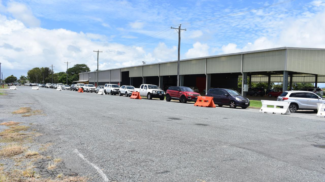 Dozens of cars line up at the drive-through COVID clinic at Mackay showgrounds on Sunday, January 3 2021.