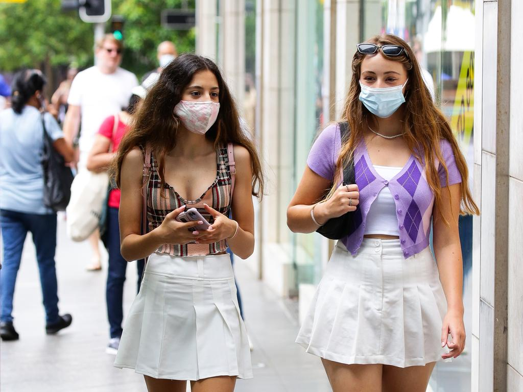 Ava Ghahreman and Diana Sharma (pictured) were among the Sydneysiders who donned masks to go out and about this week. But not everyone has followed the rules, with one man charged and two others fined. Picture: NCA NewsWire / Gaye Gerard