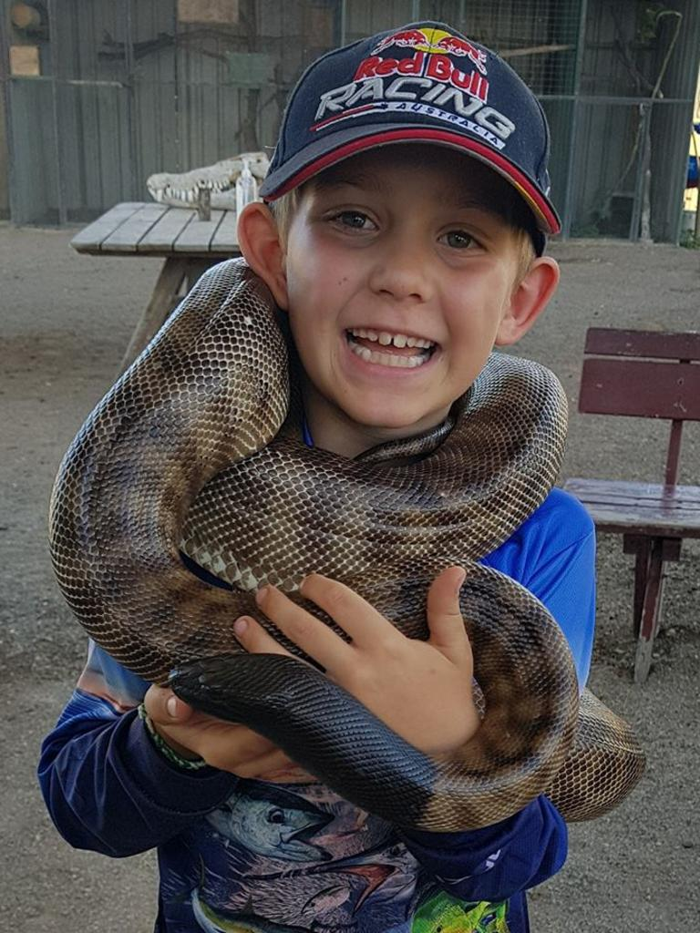 A tourist with a black headed python at Bredl's Wild Farm, Bloomsbury. Picture: Contributed