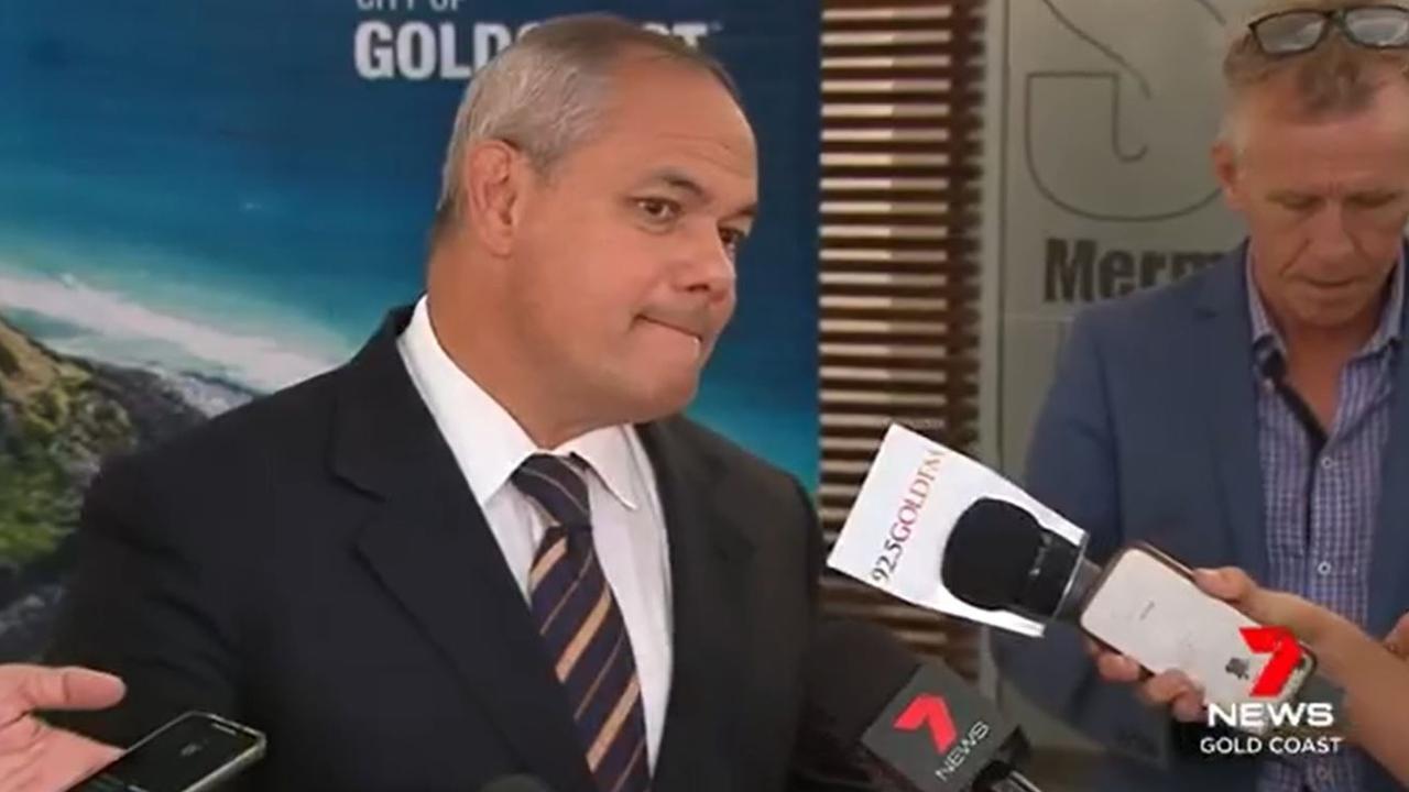 Warwick Sinclair seen behind Mayor Tom Tate.