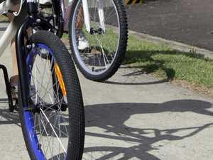 Paramedics rush to treat bike rider struck by car