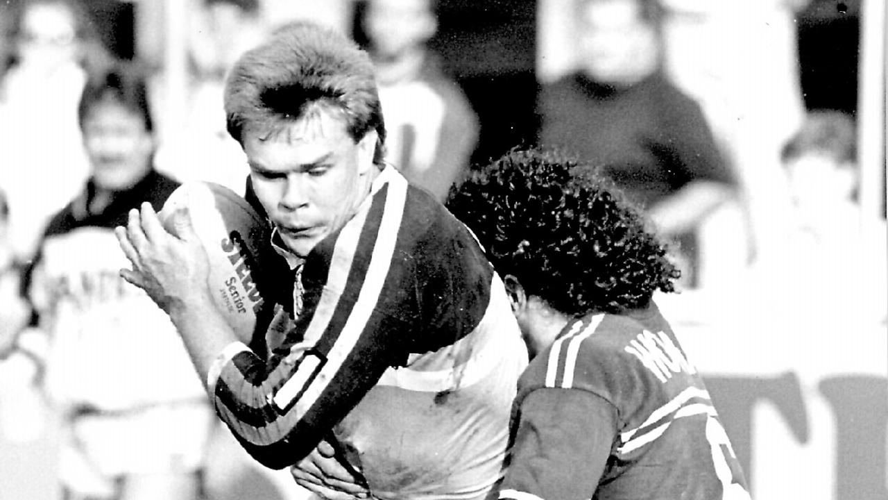 Troy McCarthy tackled by Cliff Lyons. Gold Coast v Manly. Pic Wayne Jones. 06/06/88.