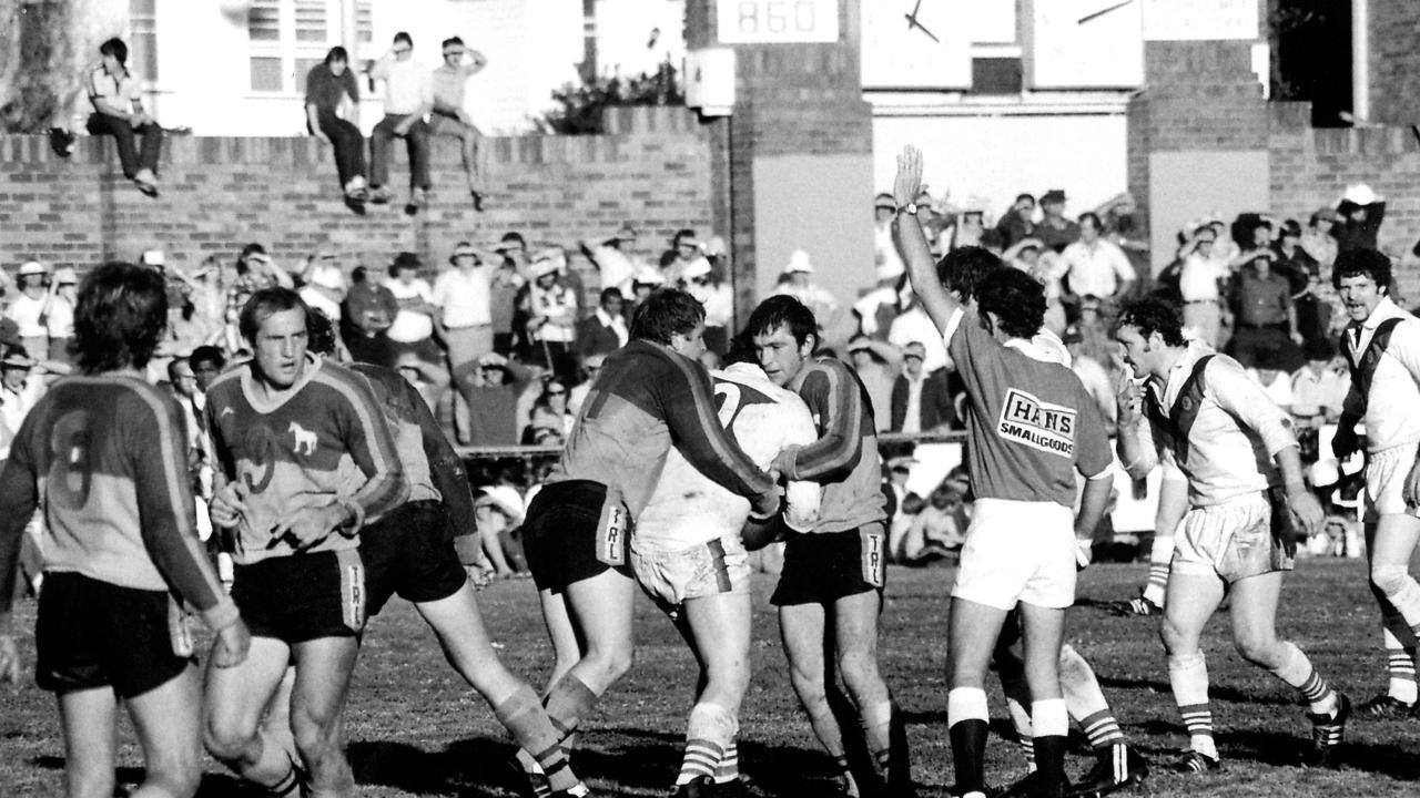 A Great Britain forward runs into the defence of Toowoomba Clydesdales prop forward Rohan Hancock (left) and second-rower Peter Connell, with Greg Platz on left (No. 9) running back into position in 1979. The mighty galloping Clydesdales won the match 19-16. Photo: By Lionel Coxen compliments of Allora Regional Sports Museum. Photo Contributed