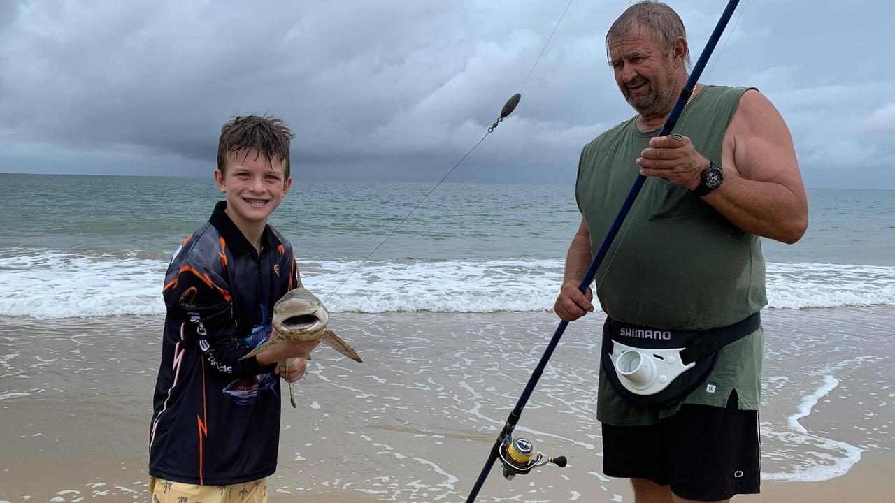 William Carroll, 8, from Andergrove, caught a 90cm shark while fishing with his grandad Carl Browarczyk at Blacks Beach on Wednesday December 6. He said he also caught a 2.5m shark recently. Picture: Tara Miko