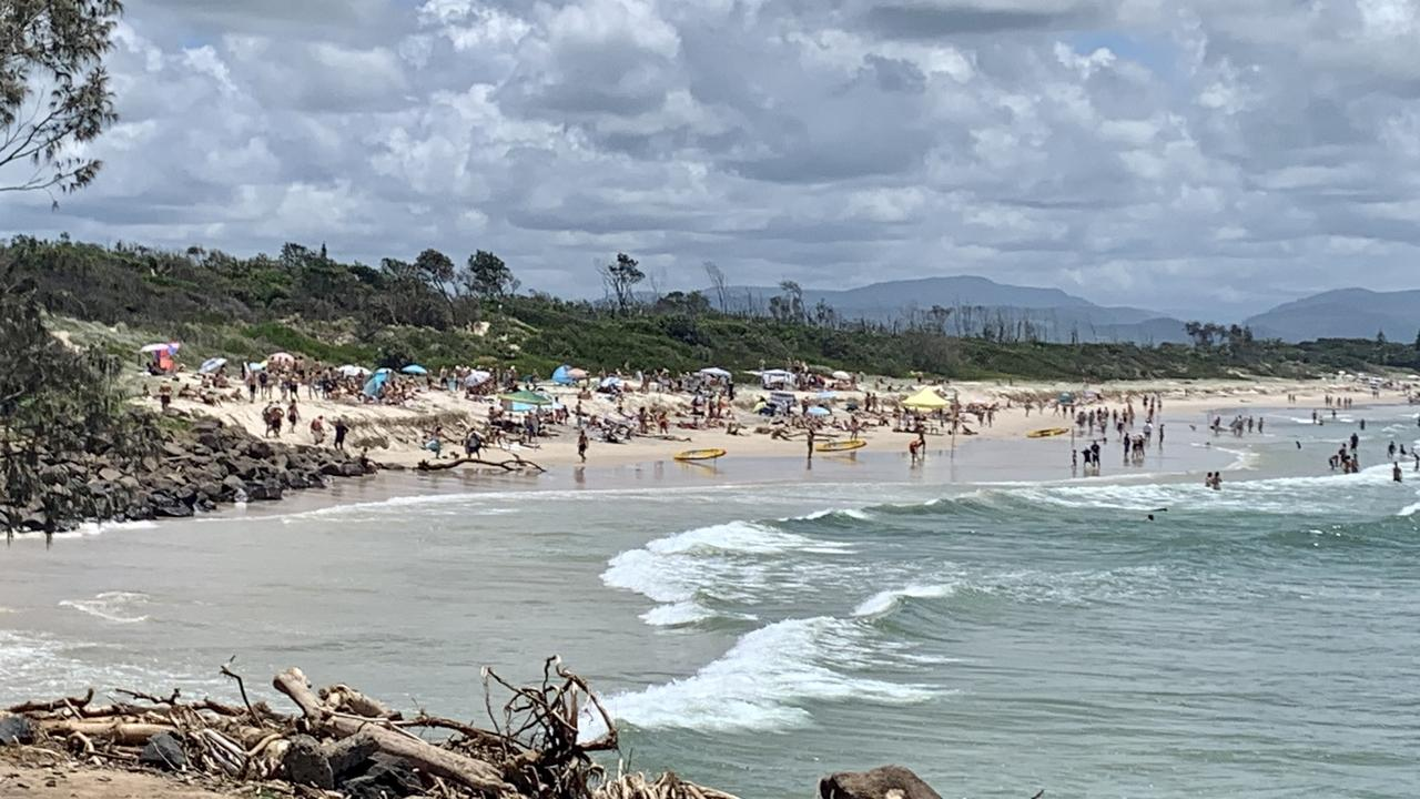 Thousands of tourists enjoy the sunny weather at Byron Bay.