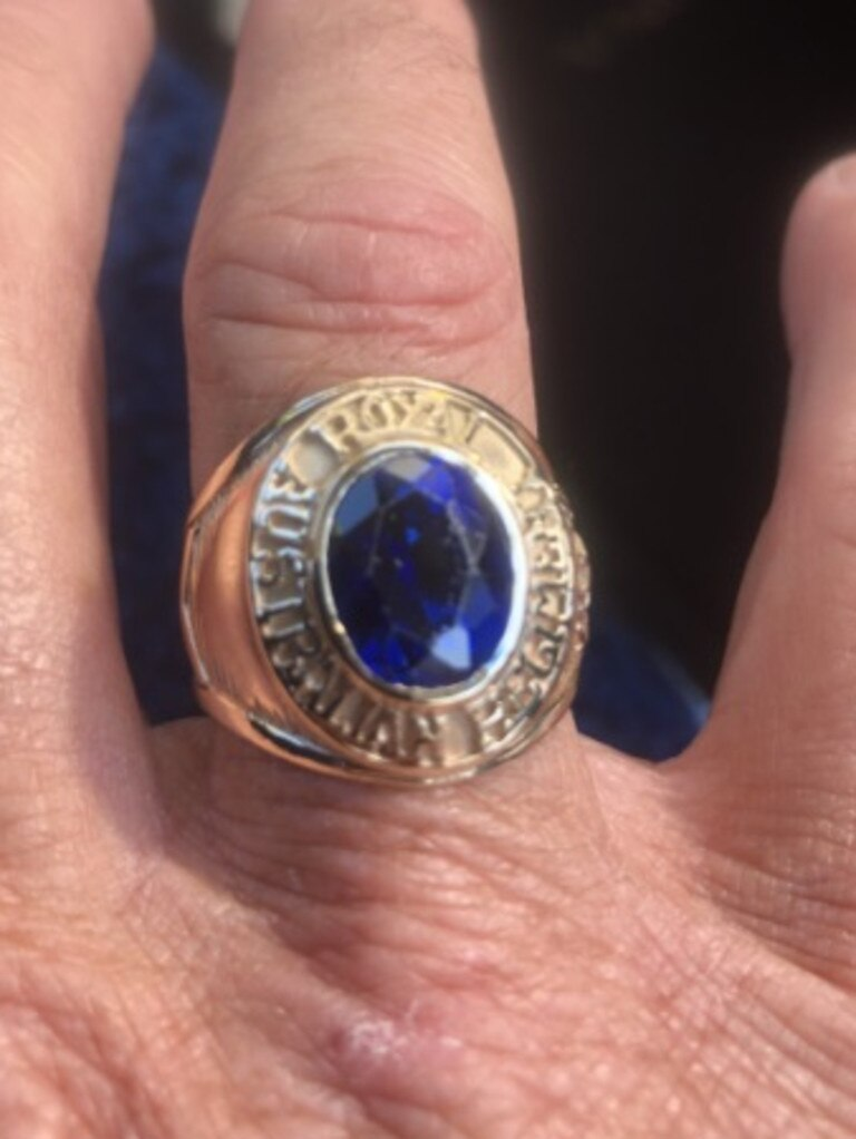 Described as gold coloured with a blue circle in the centre, the ring also has the words 'Royal Australian Regiment' inscribed around the outside of it.
