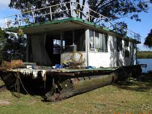 Squatters without home as vandalised houseboat removed