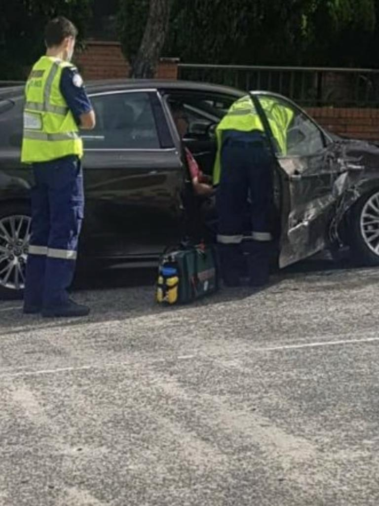 Paramedics check on Mr Albanese just after the crash. Picture: Facebook