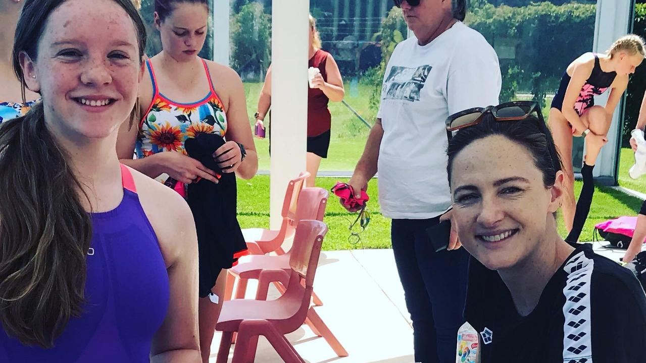 Clarence Valley swimming star Andrea Thomson meeting Australian Olympian Cate Campbell at the Glen Innes Short Course swimming championships.