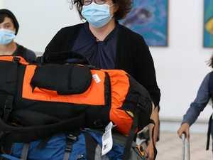 'Surreal' scenes at Brisbane airport as CQ women evacuate