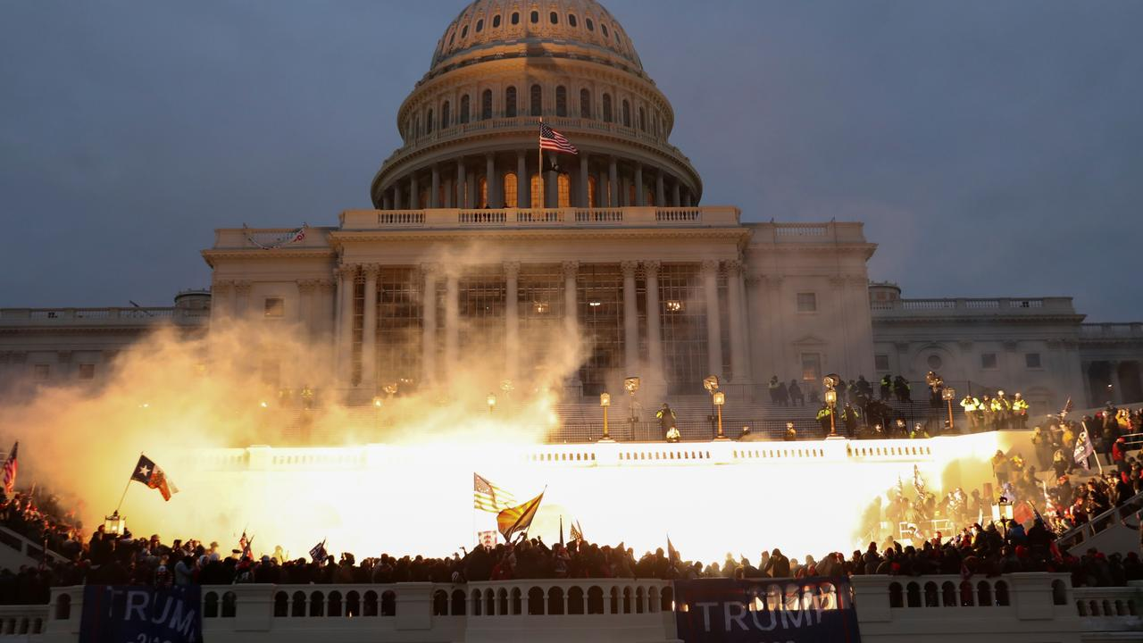 An explosion caused by a police munition is seen while supporters of Donald Trump gather in front of the U.S. Capitol Building. Picture: Reuters/Leah Millis