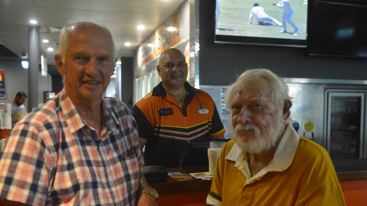 Jim Mullamphy (left) of Walkerston and former sugar mill colleague Lloyd Hermann (right) also of Walkerston, caught up over beers, as served by Western Suburbs Leagues Club General Manager Kingsley Theiber. Photo: Callum Dick
