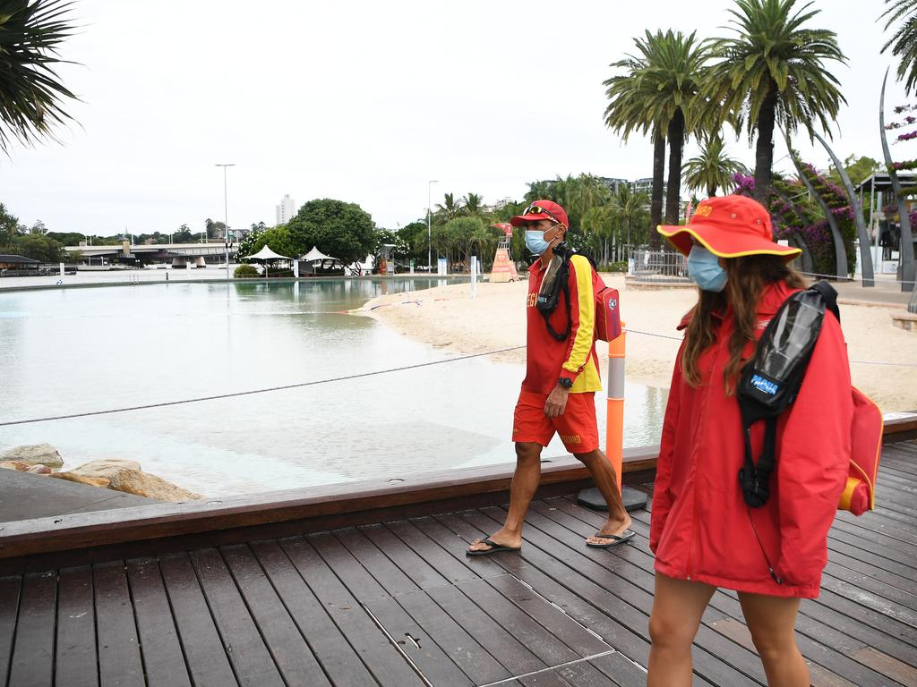 Lifeguards secure an empty Southbank beach. Picture: NCA NewsWire / Dan Peled