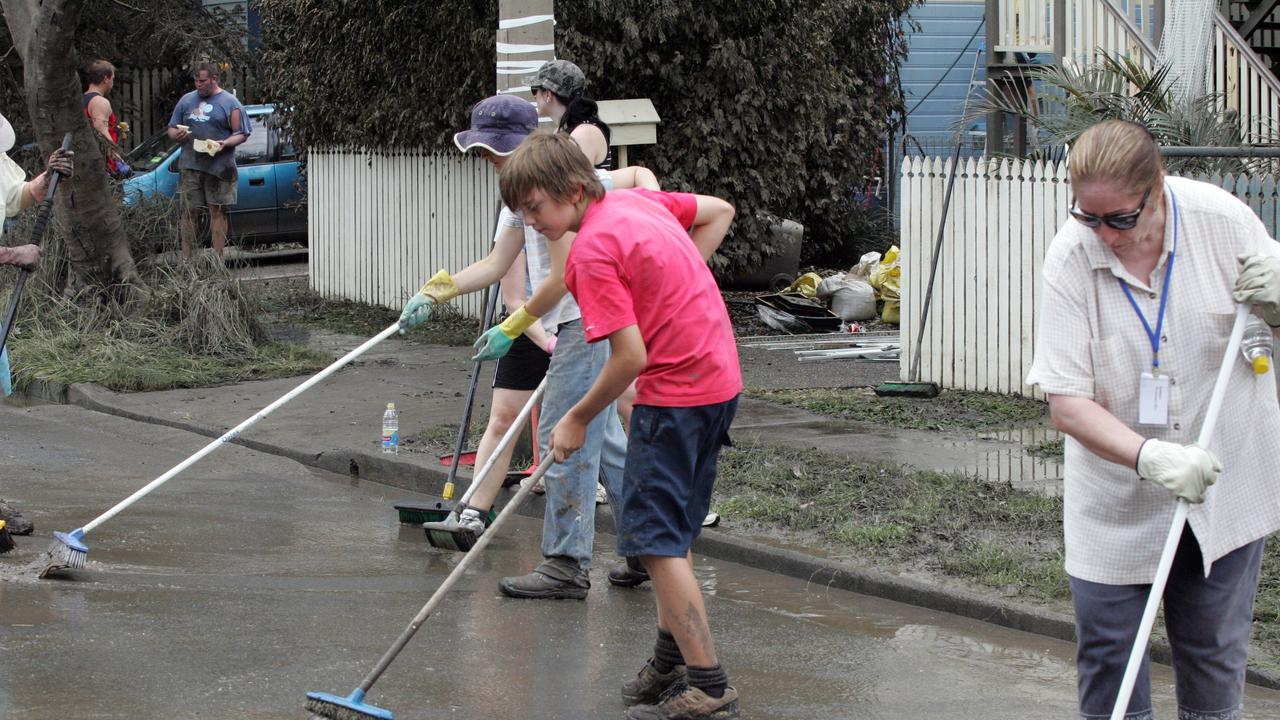 People in Torwood and Vincent St moving flood water from street in 2011.