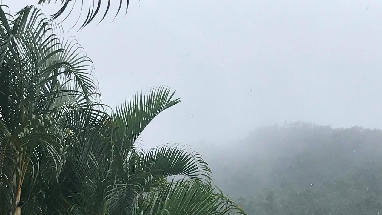 Showers are hanging around the Whitsundays on Sunday but heavy rainfall has eased. Photo: Elyse