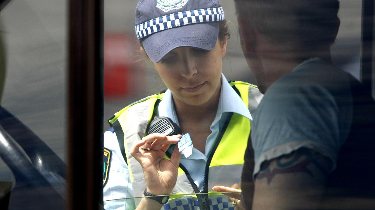 A police officer performs a random drug test.