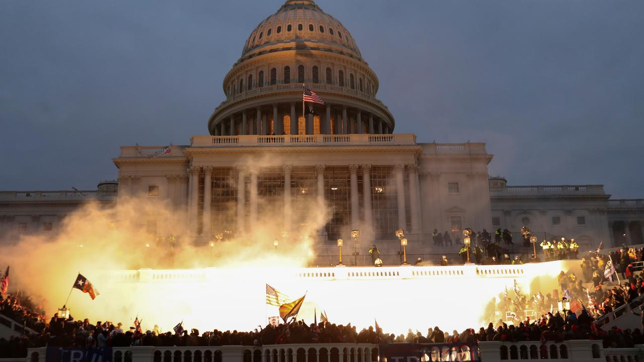 An explosion caused by a police munition is seen while Trump supporters gather in front of the Capitol Building. Picture: Leah Millis/Reuters