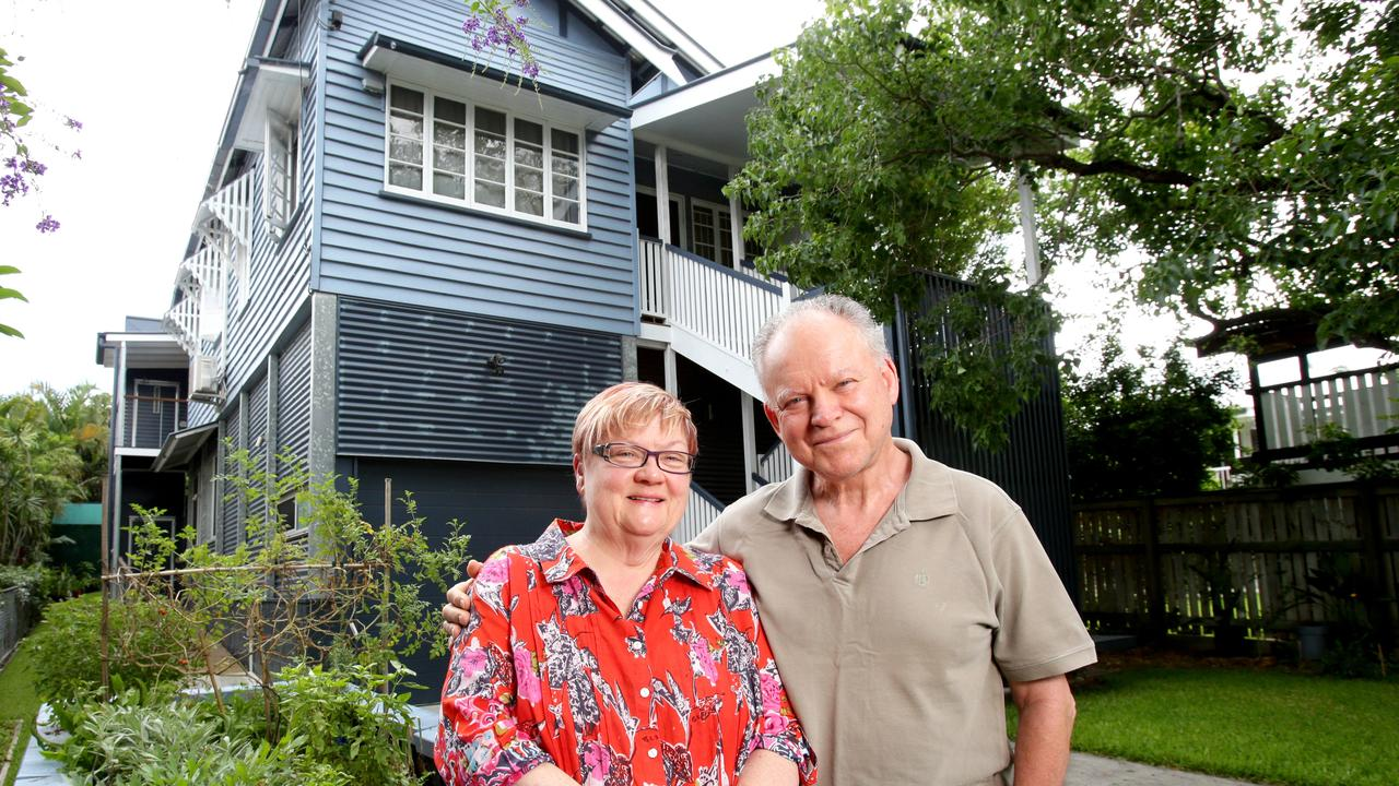 Kate Peters and Greg Woodbury, out front of their home which they had raised after the 2011 flood. Picture: Steve Pohlner