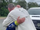 The moment the hiker is reunited with her husband. Picture: Hope Wilson/7 News Brisbane/Twitter