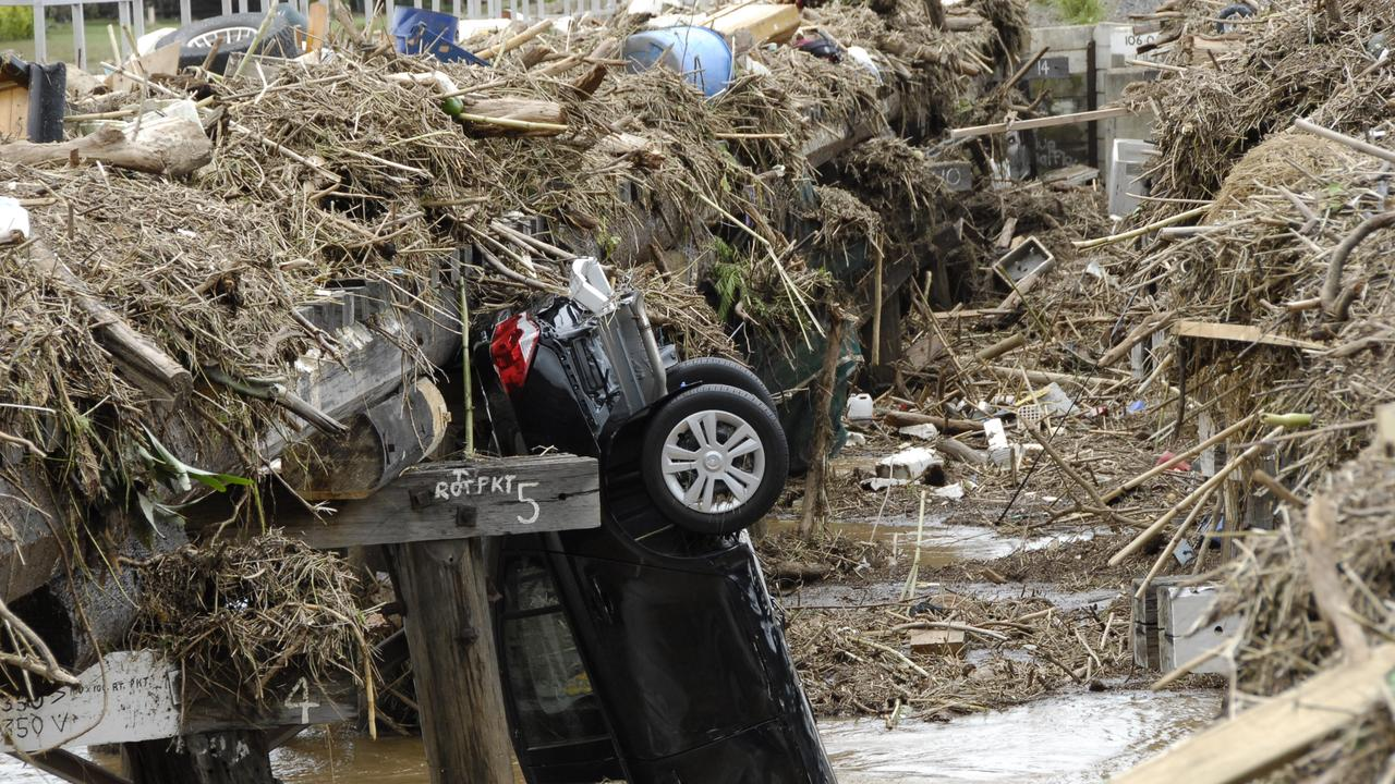 A car up-ended following flooding at Grantham in 2011. Photo Bev Lacey / The Chronicle