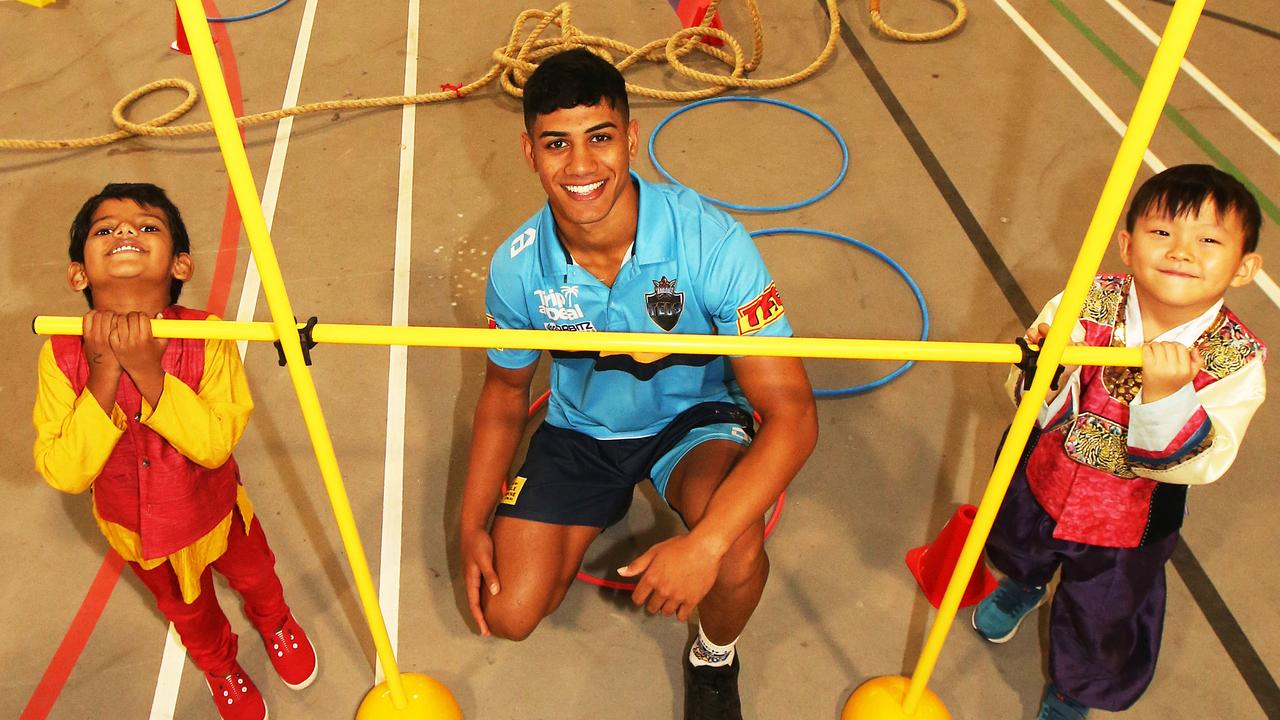Titans speed demon Alofiana Khan Pereira on a school visit. Picture Glenn Hampson