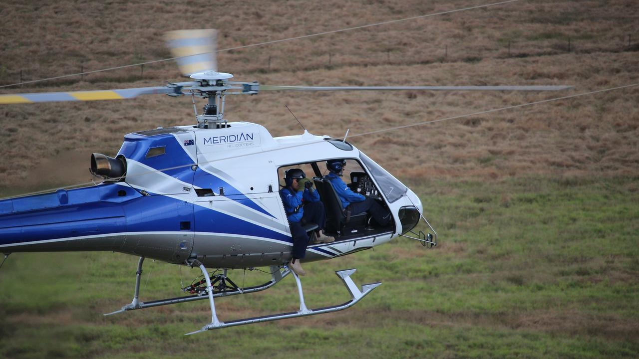 IMPROVING RELIABILITY: A Powerlink Helicopter Inspector on duty.