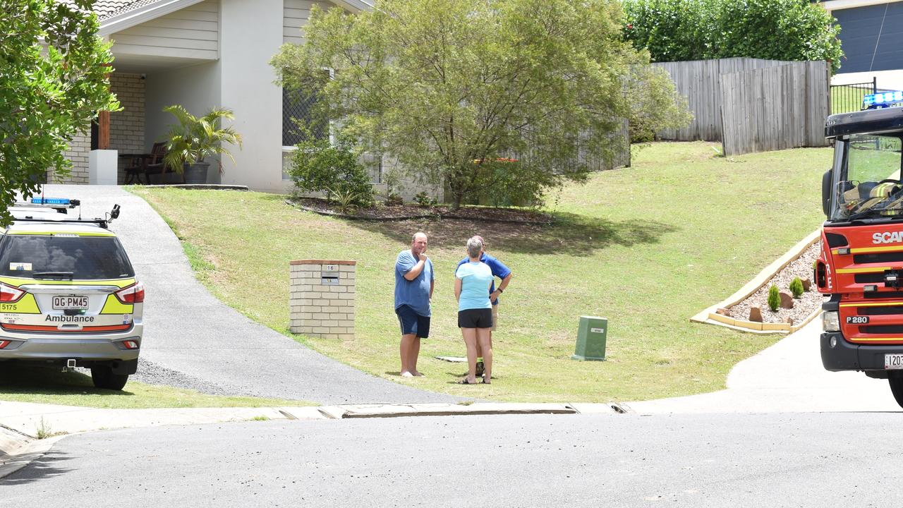 Neighbours at the scene of a forklift rollover at Chuwar.