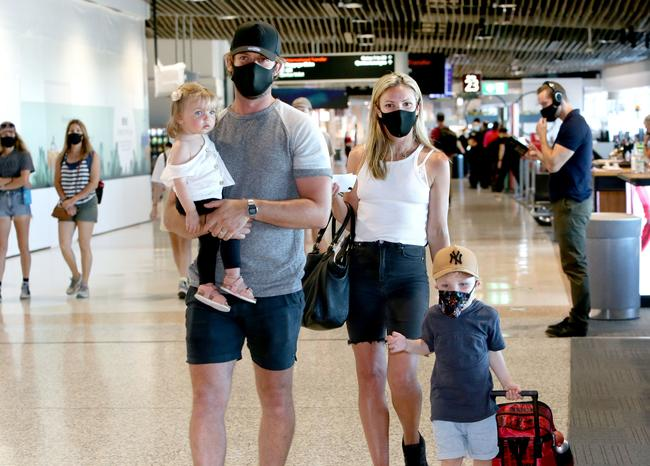 Anthony and Natalie Molloy with kids Bella, 1, and Finn, 4, heading home to Melbourne from Brisbane Airport. Picture: Steve Pohlner.