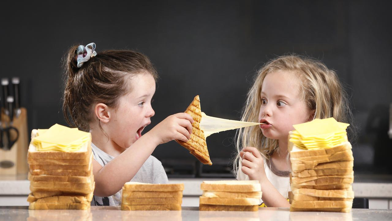 Five year-olds, Charlotte and Matisse, love a good cheese toastie, no matter what it's called. Picture: David Caird