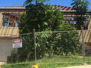 Wrecking ball swings on first home in path of bypass