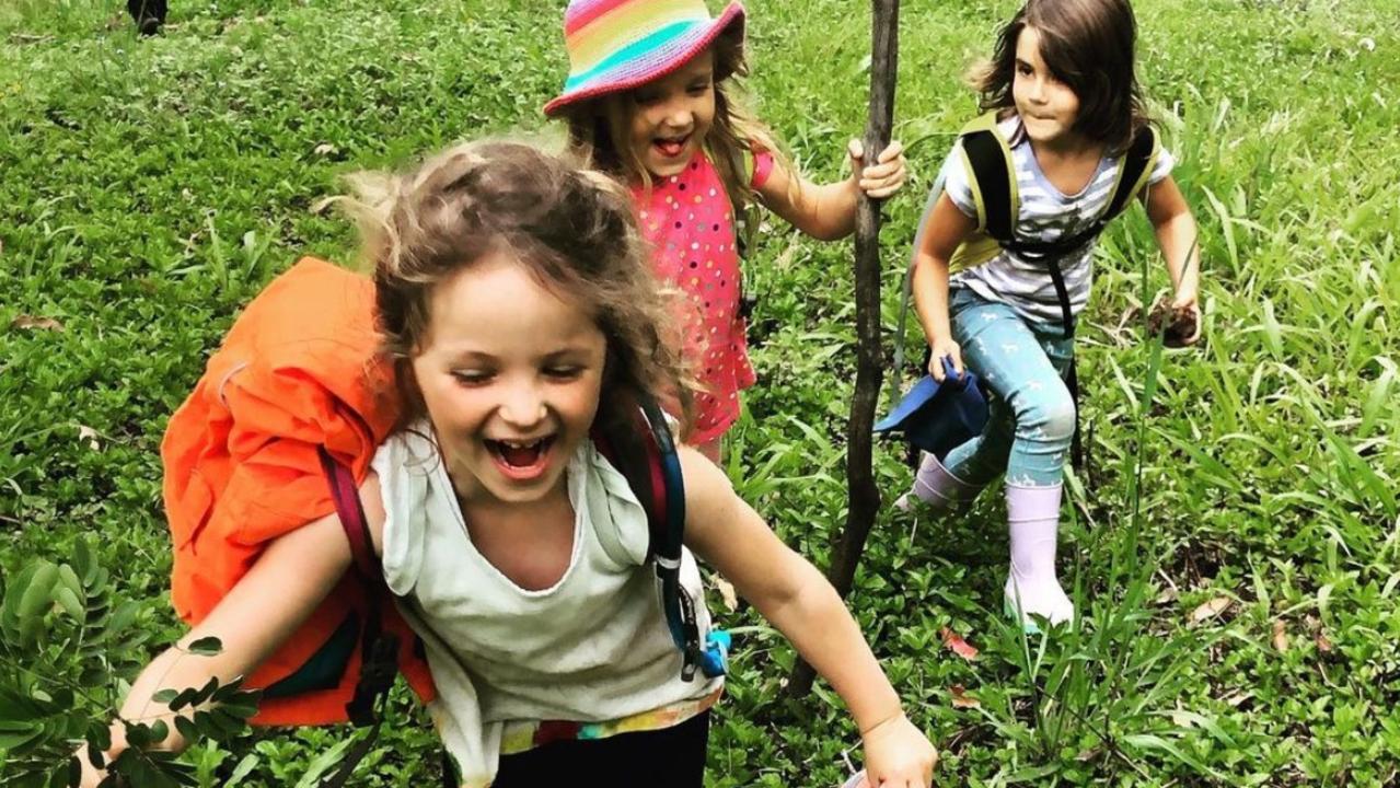 Loving being in the wild at Black Mountain's Natureweavers school is Nunyara Cadd, Frankie McKeown and Mahlia van den Aardweg