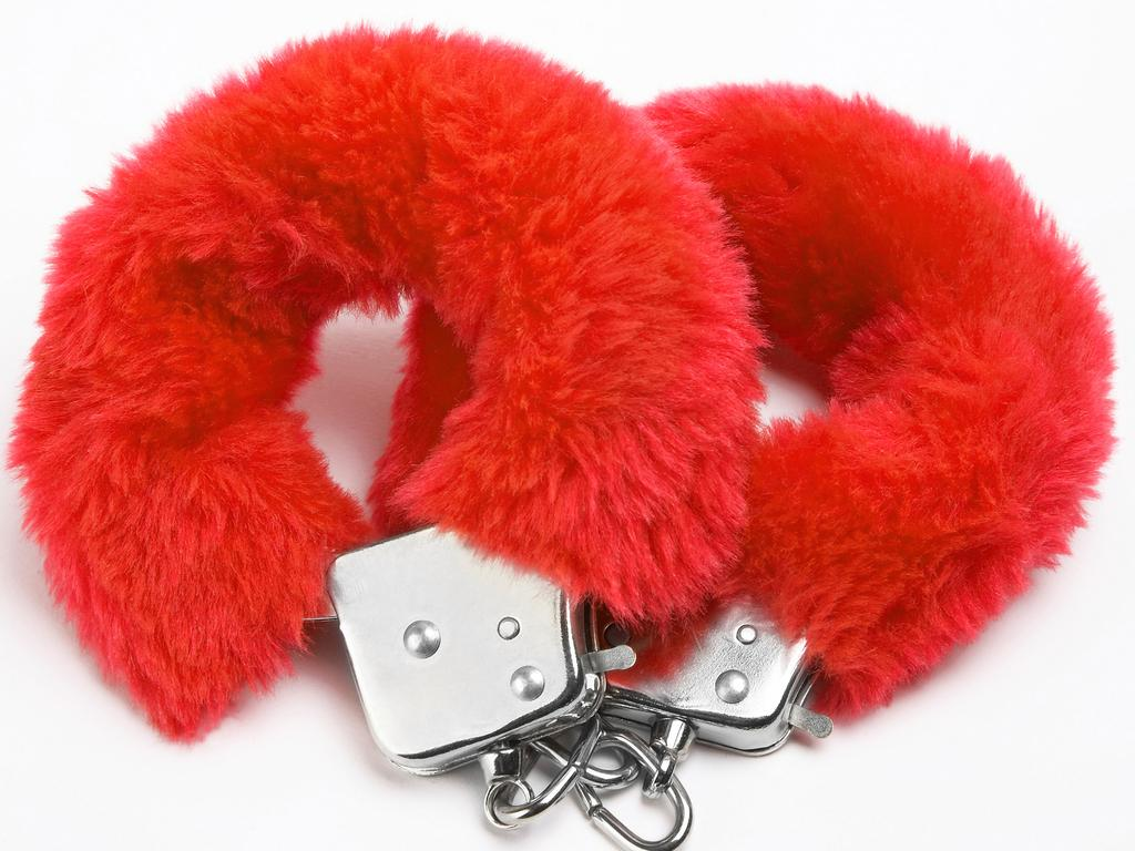 fluffy red handcuffs for story on Honey Birdette store selling sex toys in Westfield. Pic: ThinkStock