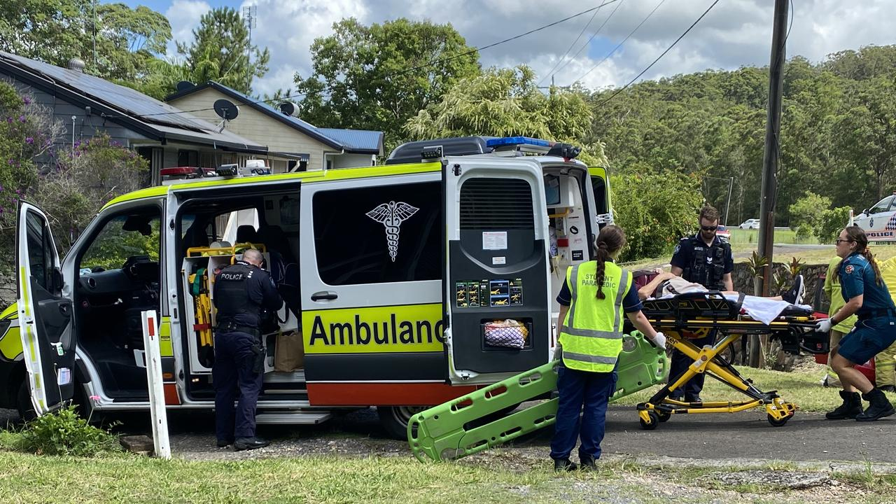 A woman in her 70s was treated for suspected spinal and head injuries after a car rollover.