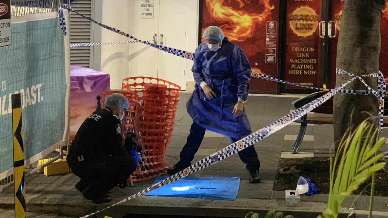Police investigate the scene of the stabbing death of 27-year-old Raymond Harris in Surfers Paradise last year.