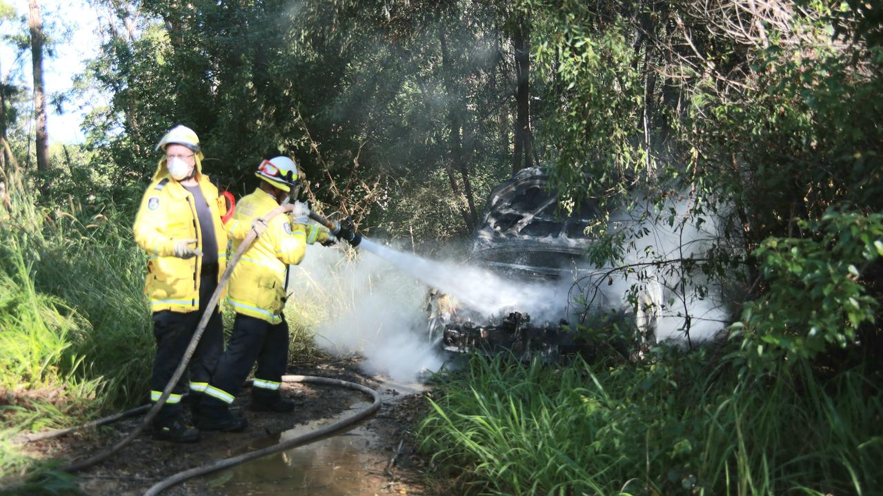 The driver torched the car off Bucca Road and ran off into bushland.