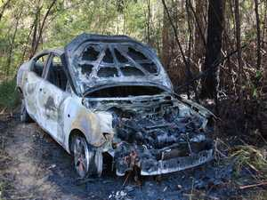Driver torched car before fleeing into bush north of Coffs