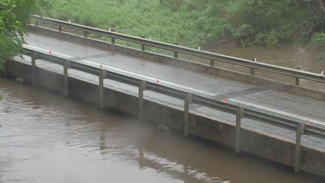 Water rose next to Crofton Creek Bridge as at 8am Monday. Photo: Whitsunday Regional Council
