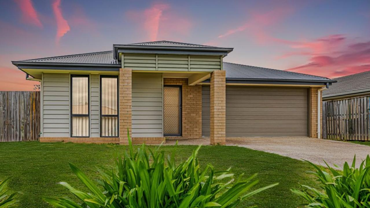 This four-bedroom house at 27 Adam St, Beachmere, has a price guide in the high $400,000s.