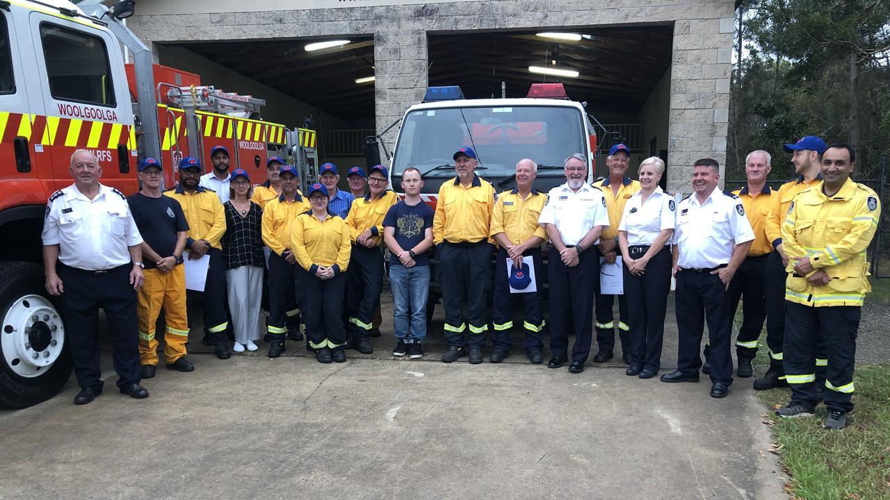 Members of the Woolgoolga RFS brigade get their Premier's citations in December for work during the 2019/20 bushfire season.