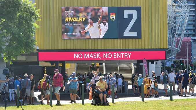 'Sense of uneasiness' as mask-clad fans descend on Gabba
