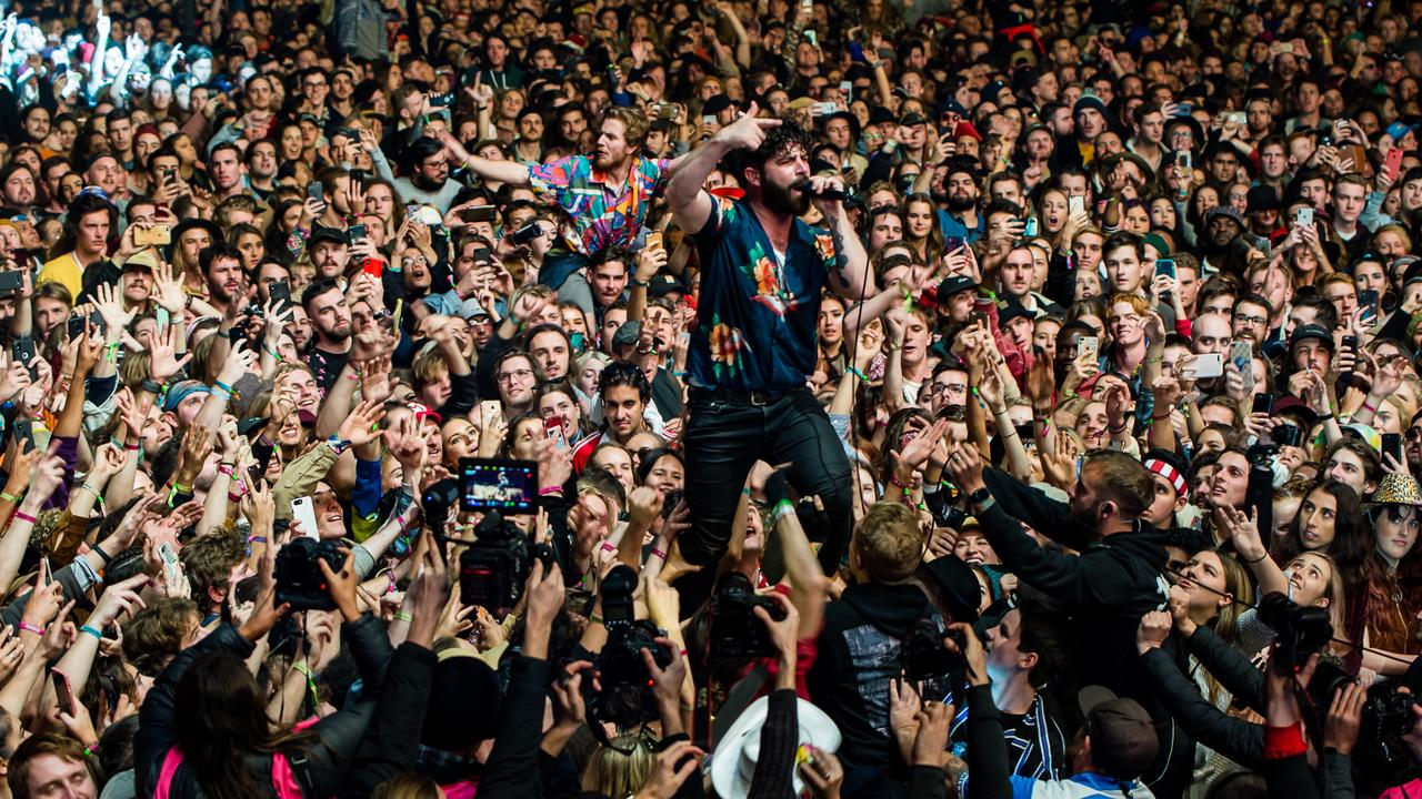 Foals front man Yannis Philippakis ventures out into the crowd during the band's set at Splendour in the Grass 2019. Supplied by SITG PR.