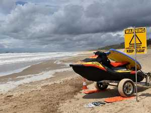 Lifesavers rescue five people as 18,000 hit the sand