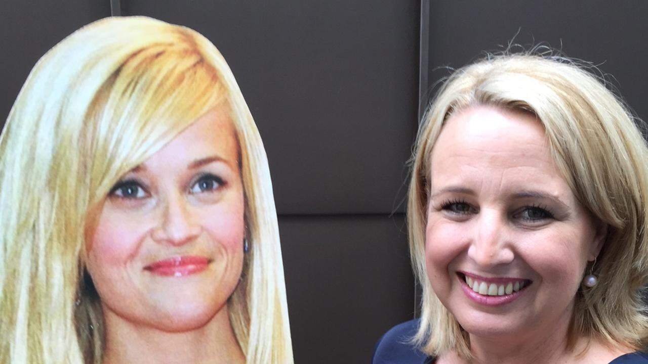 A Queensland celebrity seminar spruiker is being sued after she allegedly failed to repay a friend nearly $225,000 following a failed bid to lure Hollywood actress Reese Witherspoon to a speaking event in Brisbane.