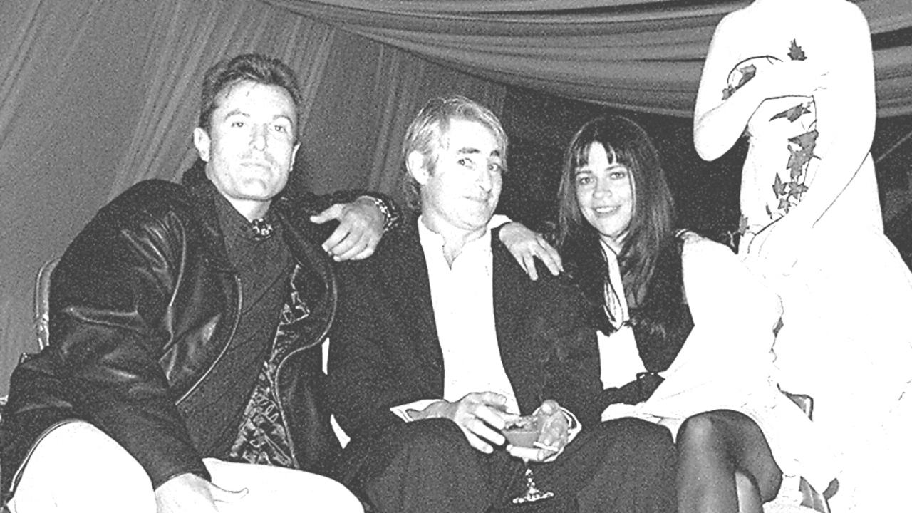 INXS' manager Chris Murphy (C) celebrated his 40th birthday with a surprise 'Arabian ice' party, actor James Reyne (L) & singer Jenny Morris. 9 November 1994
