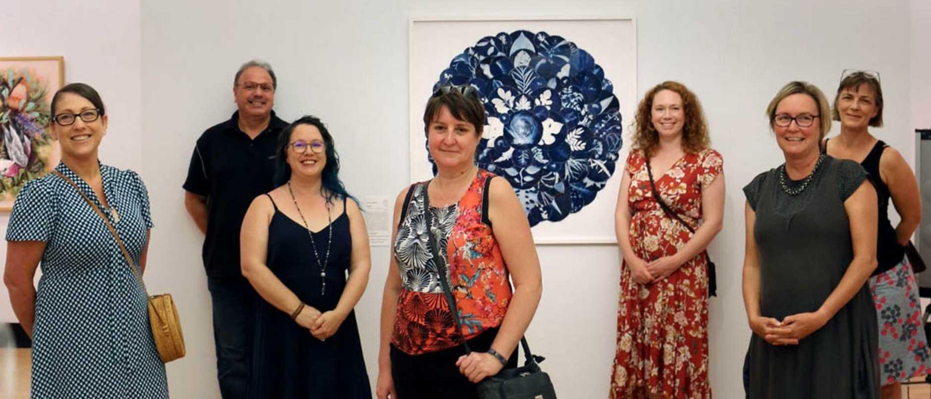 Local artists Donna Davis, Grant Quinn, Kylie Stevens, LeAnne Vincent (centre), Renee Yates, Deb Mostert and Jane du Rand. Pic: Ipswich City Council