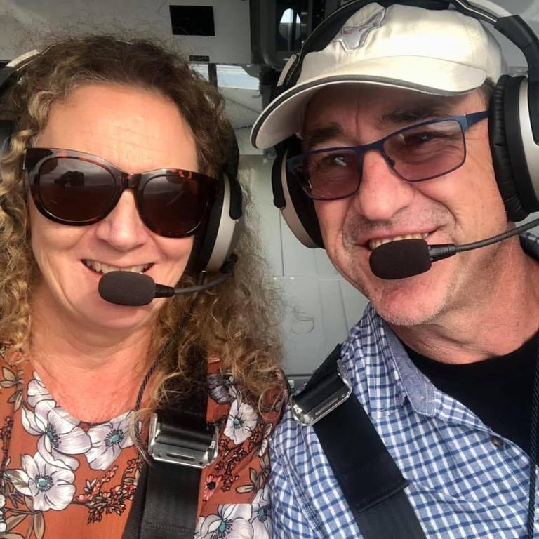 Gayle Kee and her partner Trevor John in their light plane.