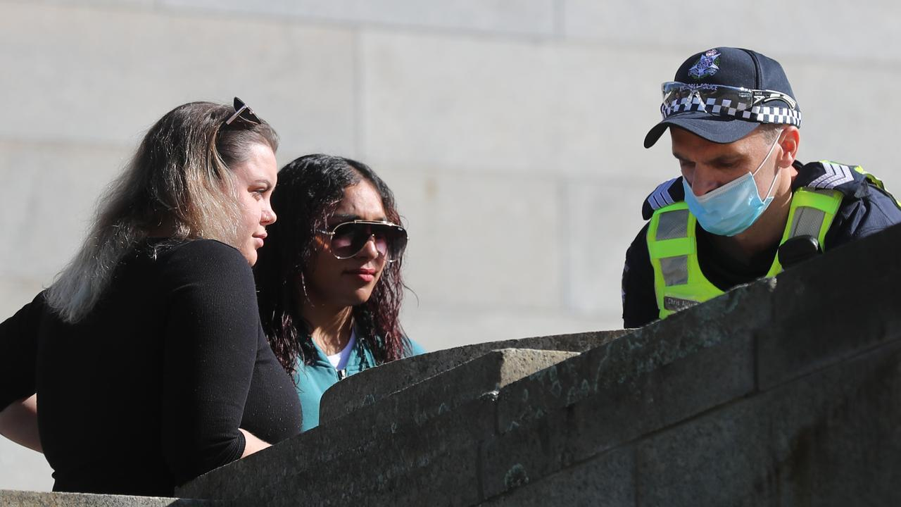 Two women are fined for not wearing masks at the Shrine of Remembrance in Melbourne. Picture: Alex Coppel.